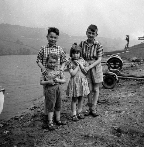 Beside Rudyard Lake, with Mike on the right, and Geoff and Sue on the left. We have no idea who the other little girl is, next to Mike.