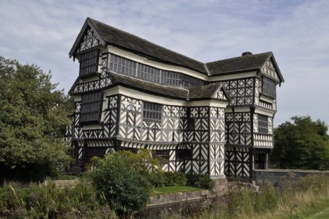 The main entrance to Little Moreton Hall, over the moat. This photo shows the south face of the hall.