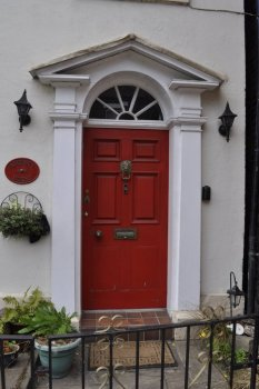 No 13, now pretentiously named 'Regency House' has the same door, brass door knocker, handle and letter box as 60 years ago.