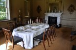 The dining table - with original 18th century furniture and crockery.
