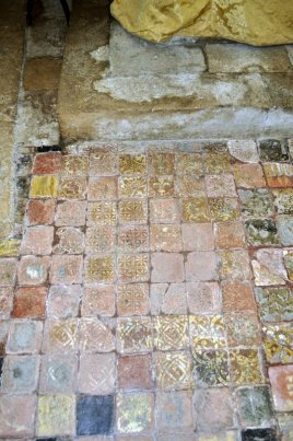 Floor tiles below the altar, possibly taken from the abbey after the Dissolution
