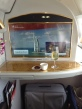 Wide screen TV . . . and a glass of champagne and a small cup of Arabic coffee before take-off