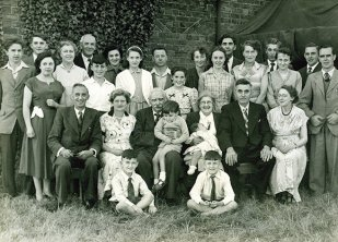 The Golden Wedding in 1954. I'm sitting on the ground on the left (aged five).