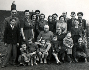 With our extended family at Hollington in 1950. I'm the little boy standing on the left, being hugged by my sister Margaret.