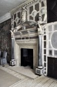 Fireplace in the Green Velvet Bedroom, made from various Derbyshire stones.