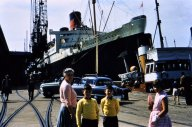 Alongside RMS Queen Mary.