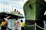 That's the RMS Queen Mary in the distance, and green-hulled RMS Caronia close-by.