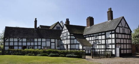 To the left is the dairy, with the Tudor and 17th century hunting lodge in the centre. The Victorian wing is on the right, painted in black and white to represent a half-timbered Tudor construction.