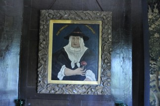 This 17th century portrait hangs above the fireplace in the Oratory.