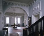 The Entrance Hall at Florence Court, from the staircase. Fine plasterwork includes the entablature with a frieze of triglyphs. Note: Side table to the right is not shown with leaves extended.