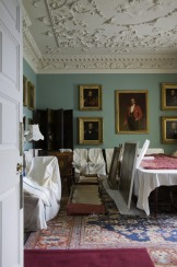 The Dining Room with dust covers over the chairs and table, and paintings off the wall, during the winter months of housekeeping at Florence Court, Co. Fermanagh, Northern Ireland.