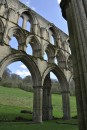 Rievaulx Terrace can be seen above the ruins high on the hillside beyond