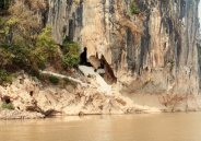 Approaching the caves from the Mekong